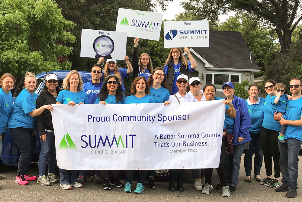 Image of Summit State Bank employees helping in the community.